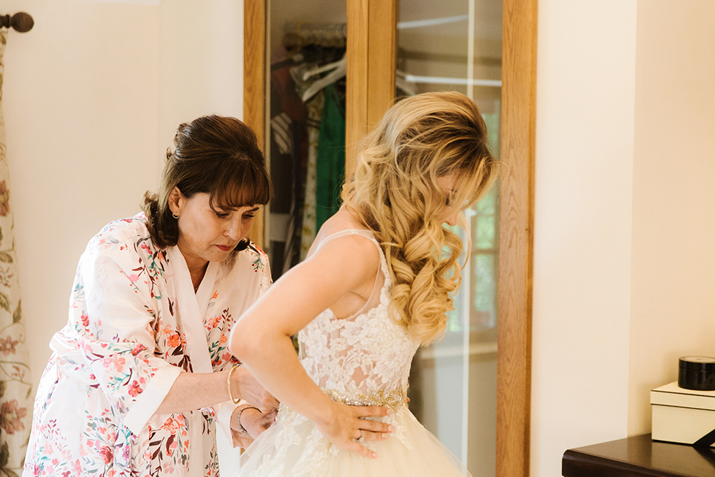 The bride prepares for her wedding at Sandhole Oak Barn in Cheshire