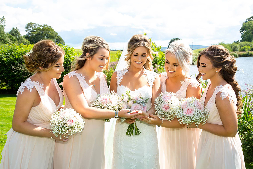 The bride enjoyed a moment with her bridesmaids after the wedding ceremony at Sandhole Oak Barn