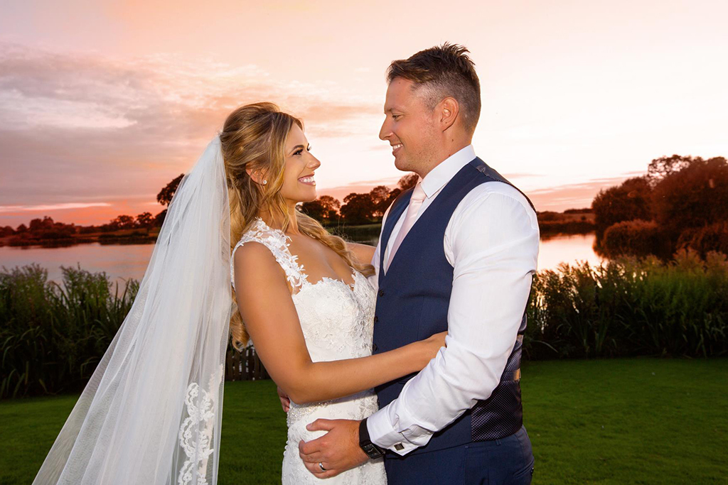 The bride and groom enjoy a moment on their wedding at this lakeside wedding venue