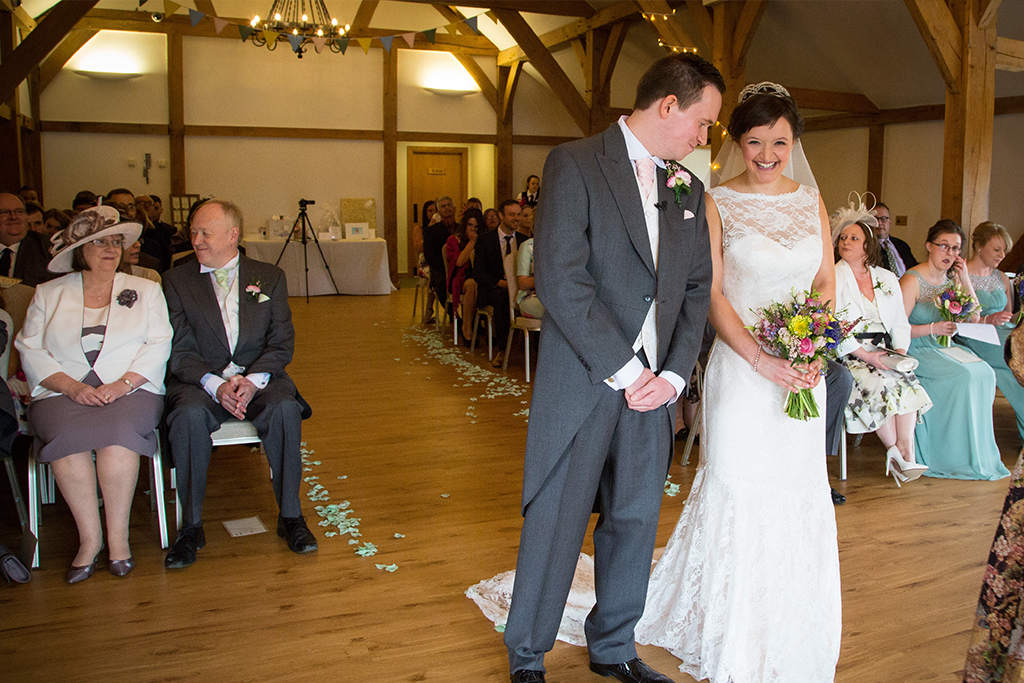 The bride and groom prepare to say their vows at this Cheshire barn venue