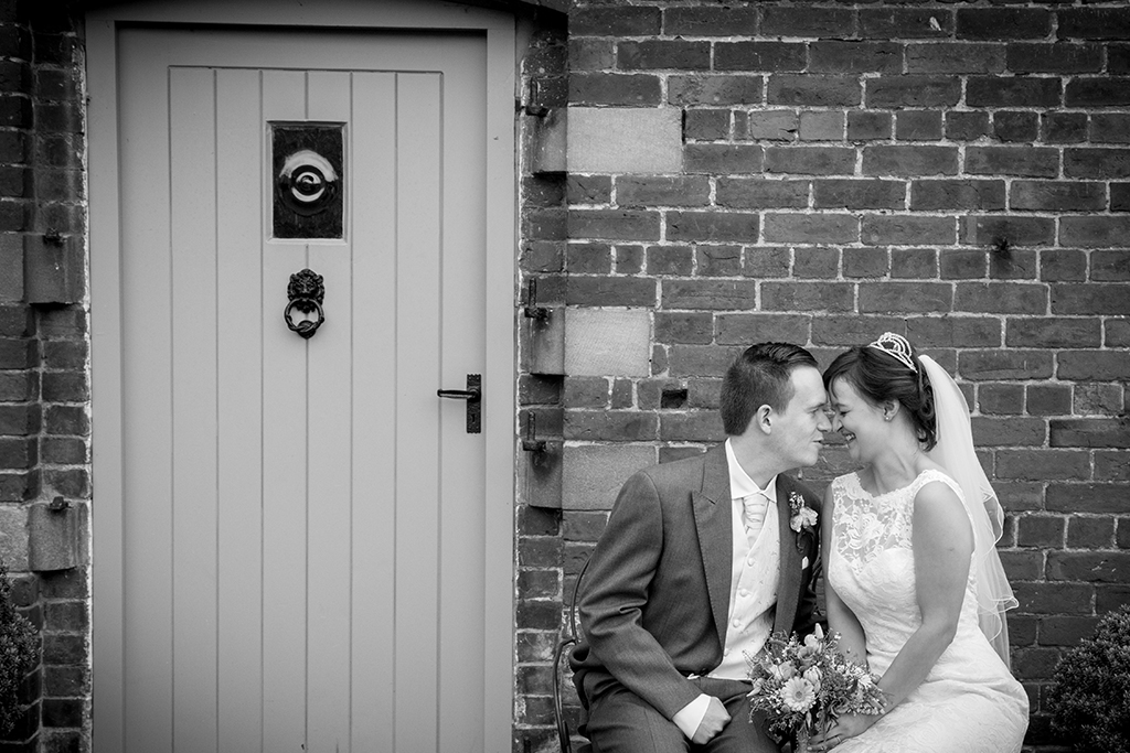 The bride and groom steal a moment together at Sandhole Oak Barn in Cheshire