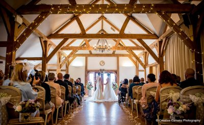 The happy couple say their wedding vows at their wedding ceremony at Sandhole Oak Barn near Manchester
