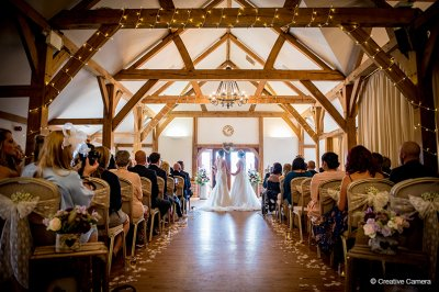 The happy couple take their wedding vows in the Oak room at this exclusive wedding venue in Cheshire