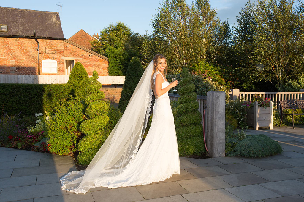 The bride looks stunning in her bridal gown at Sandhole Oak Barn in Cheshire