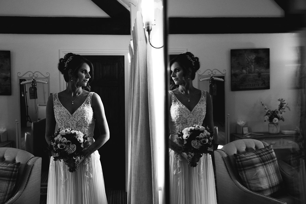 The bride prepares for the day ahead at her wedding at Sandhole Oak Barn