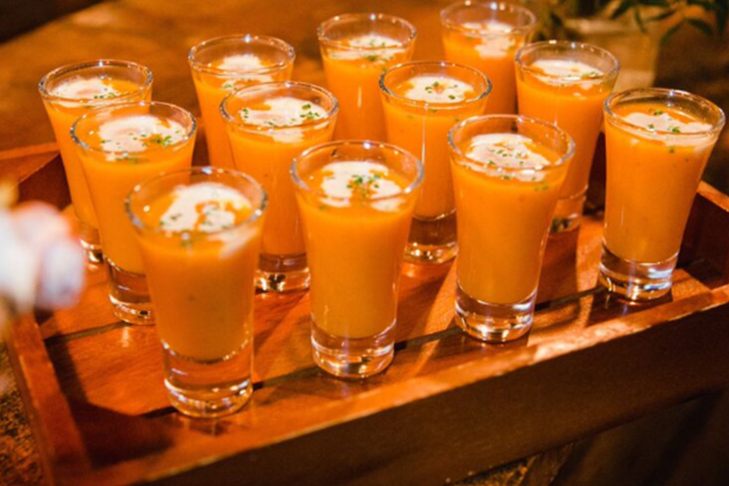Spicy butternut soup shots are perfect to serve at your winter wedding drinks reception at Sandhole Oak Barn In Cheshire