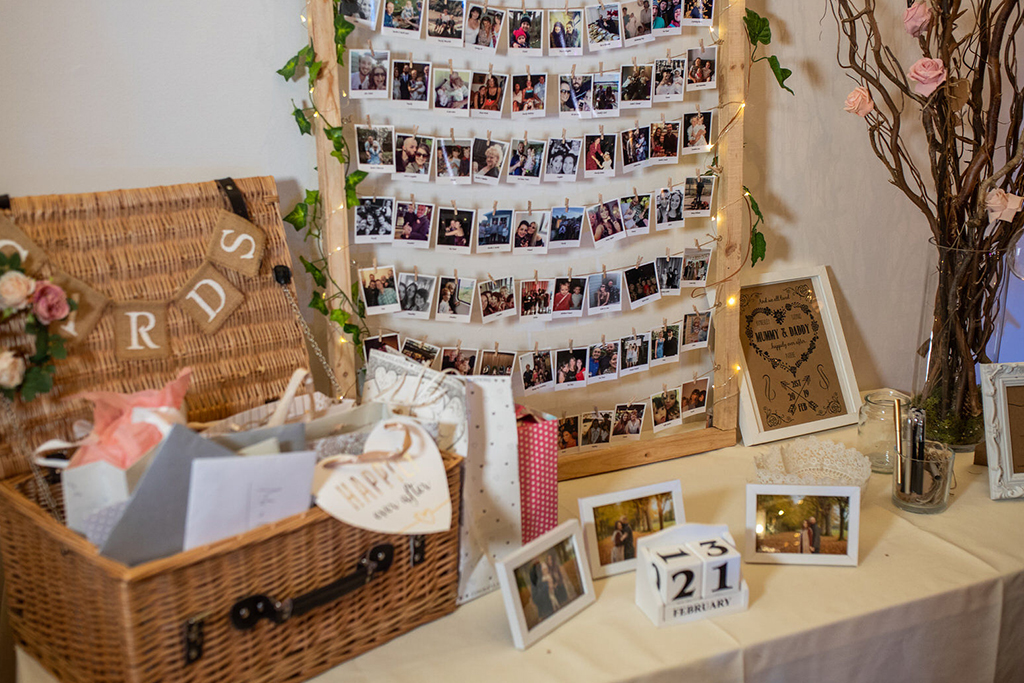 The card table was decorated with a displays of photos of the happy couple at Sandhole Oak Barn