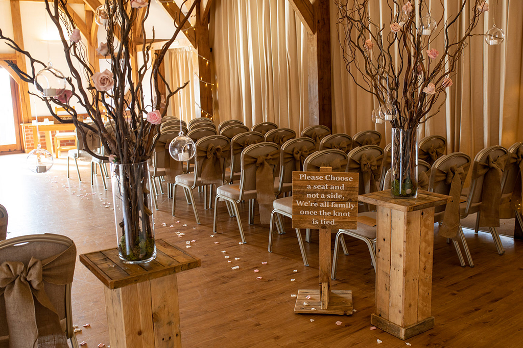 The oak barn was set up for the wedding ceremony at Sandhole Oak Barn in Cheshire
