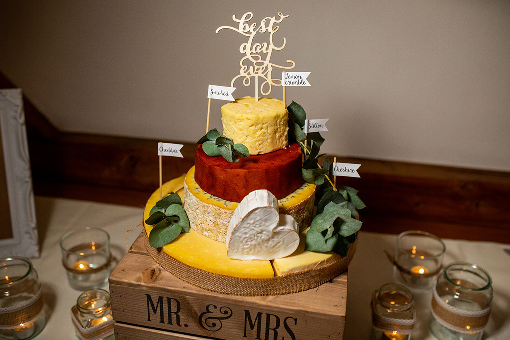 The couple opted for a cheese stack wedding cake for their wedding at Sandhole Oak Barn in Cheshire