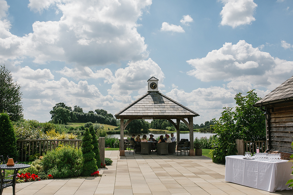 The Clock Tower at Sandhole Oak barn with it's beautiful view over the lake is the perfect place to be married or for your guests to sit and chat on a summers day