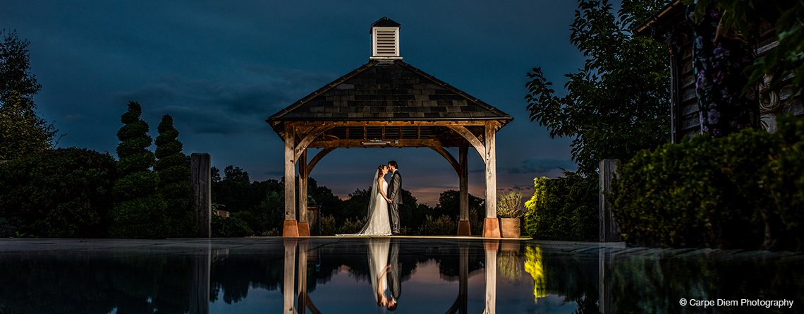 The couple had dramatic wedding pictures taken at the waterside under the Clock Tower in the evening at their barn wedding
