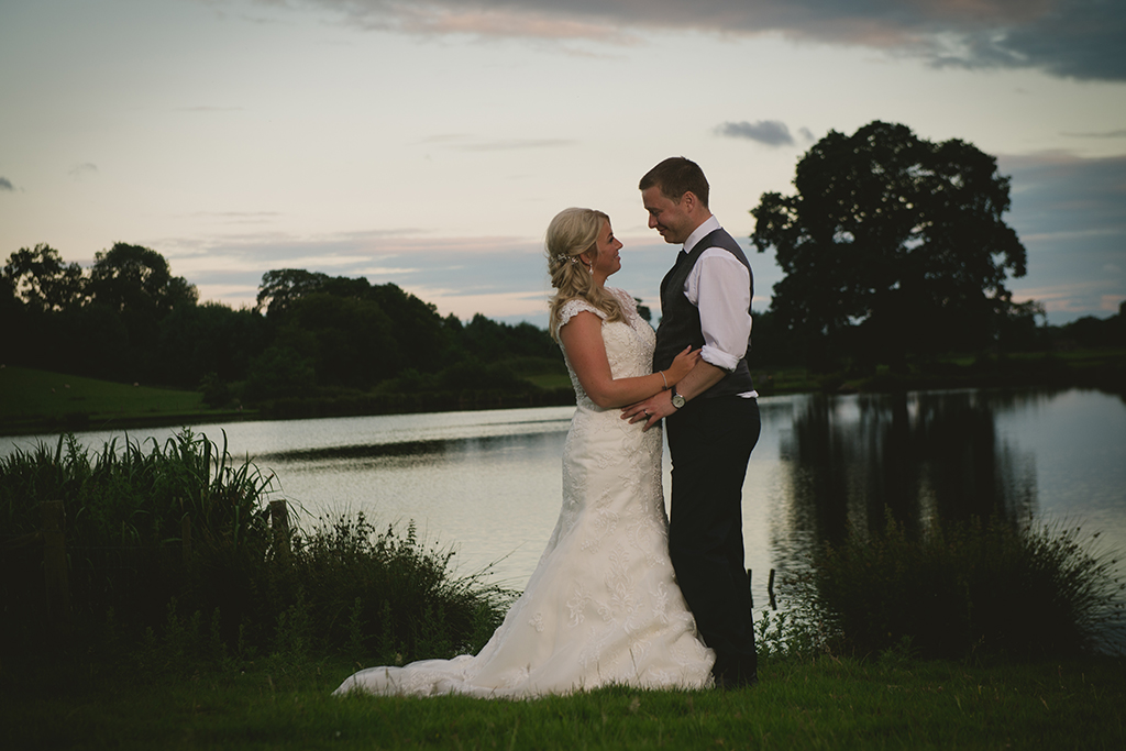 The happy couple take time at the end of the day to reflect on their special wedding day at Sandhole Oak Barn