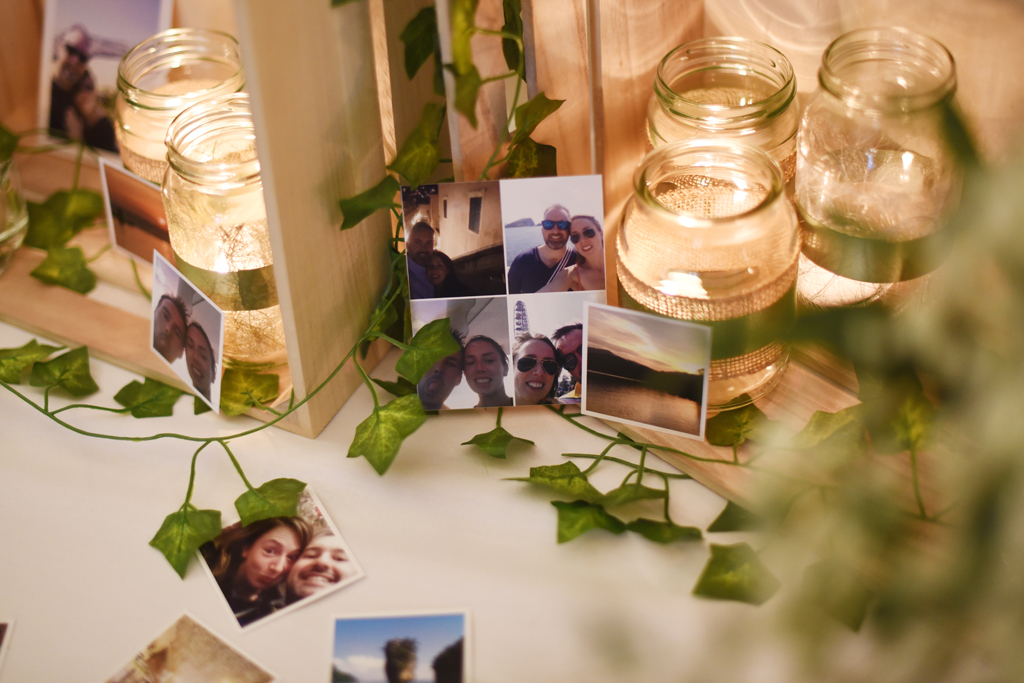 Tables were decorated with jars of tealights and photos of the happy couple at Sandhole Oak Barn