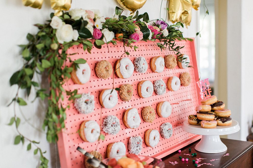 A doughnut wall is a fun alternative to a traditional wedding cake for your Cheshire barn wedding