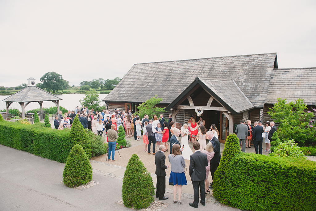 Guests enjoy the stunning countryside views outside in the courtyard during the drinks reception