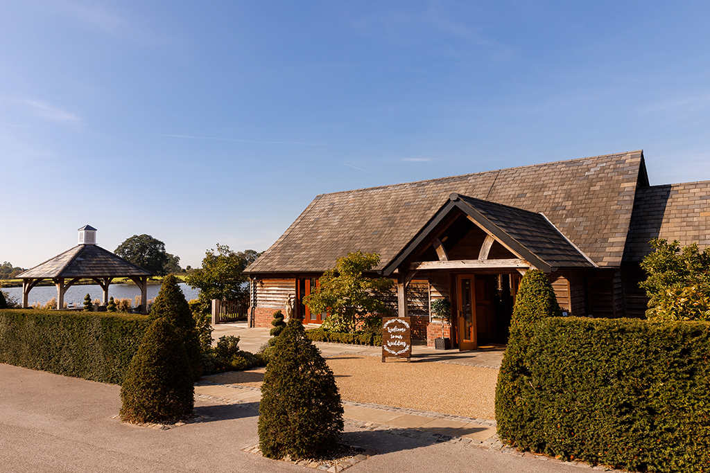 Sandhole Oak Barn with its rustic exterior and beautiful surroundings is perfect for a summer wedding