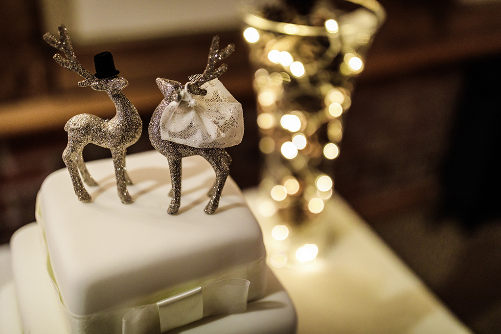 Pop a festive topper on your wedding cake for that winter wonderland feel at your wedding at Sandhole Oak Barn