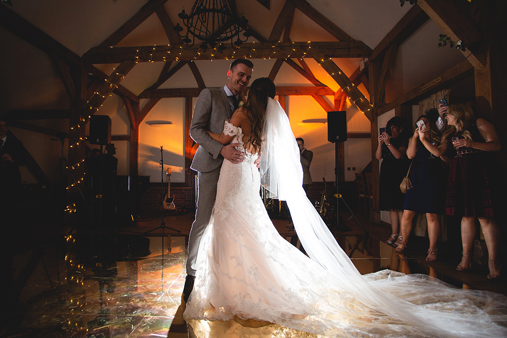 The bride and groom enjoy their first dance at their barn wedding at Sandhole Oak Barn in Cheshire