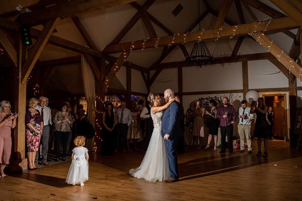 The bride and groom enjoy their first dance at Sandhole Oak Barn