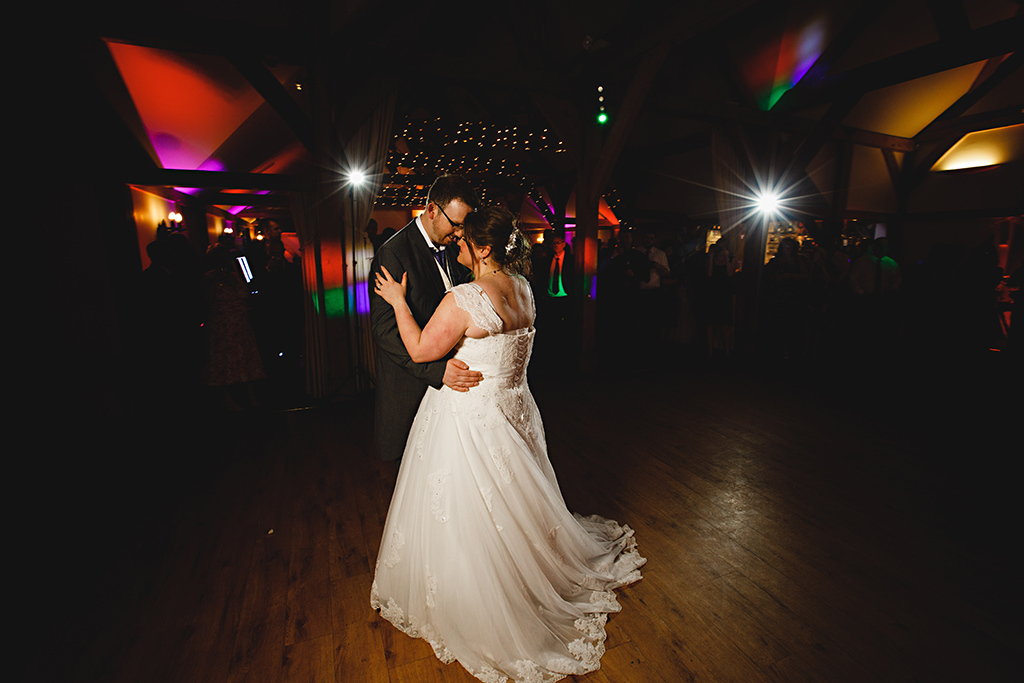 The bride and groom take to the dancefloor for their first dance at Sandhole Oak Barn