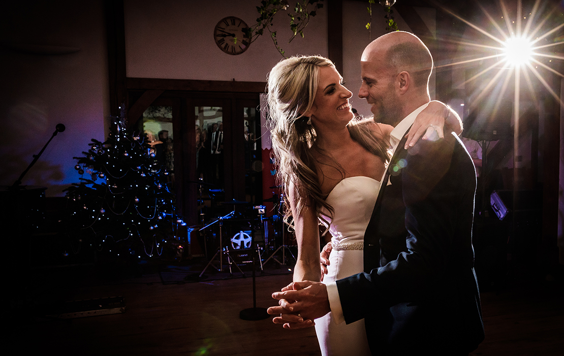 The couple enjoy their first dance at their festive winter wedding at Sandhole Oak Barn