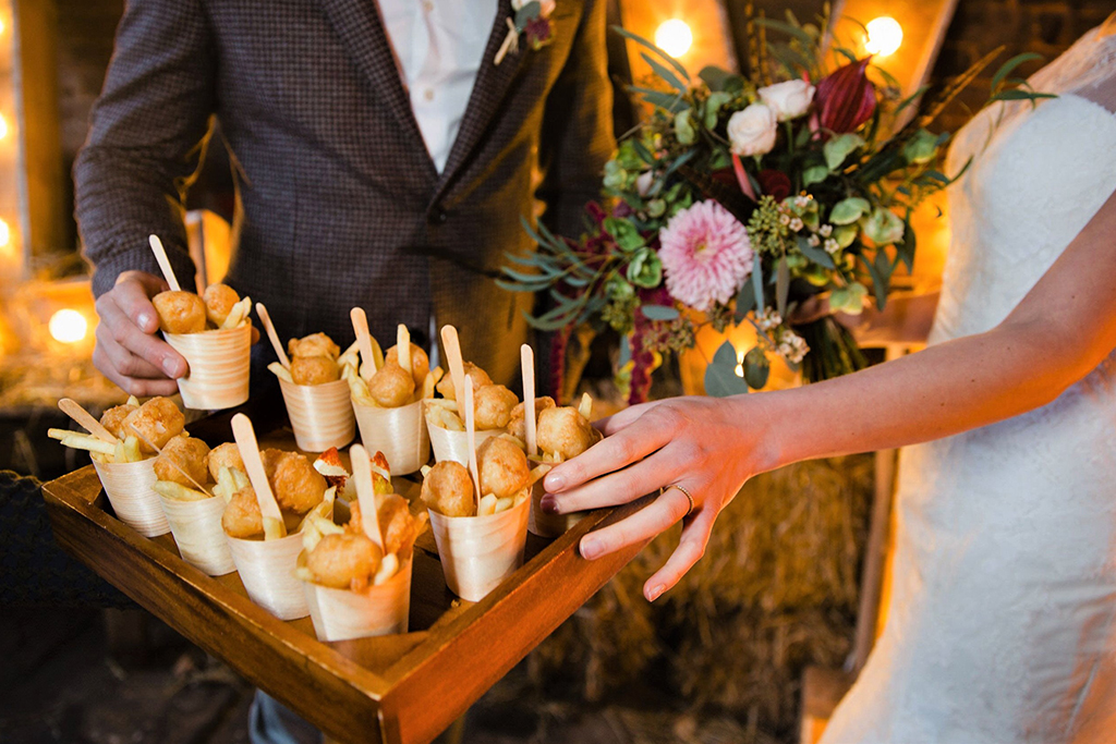 Mini cones of tasty fish and chips are bound to delight your guests at your winter barn wedding at Sandhole Oak Barn in Cheshire