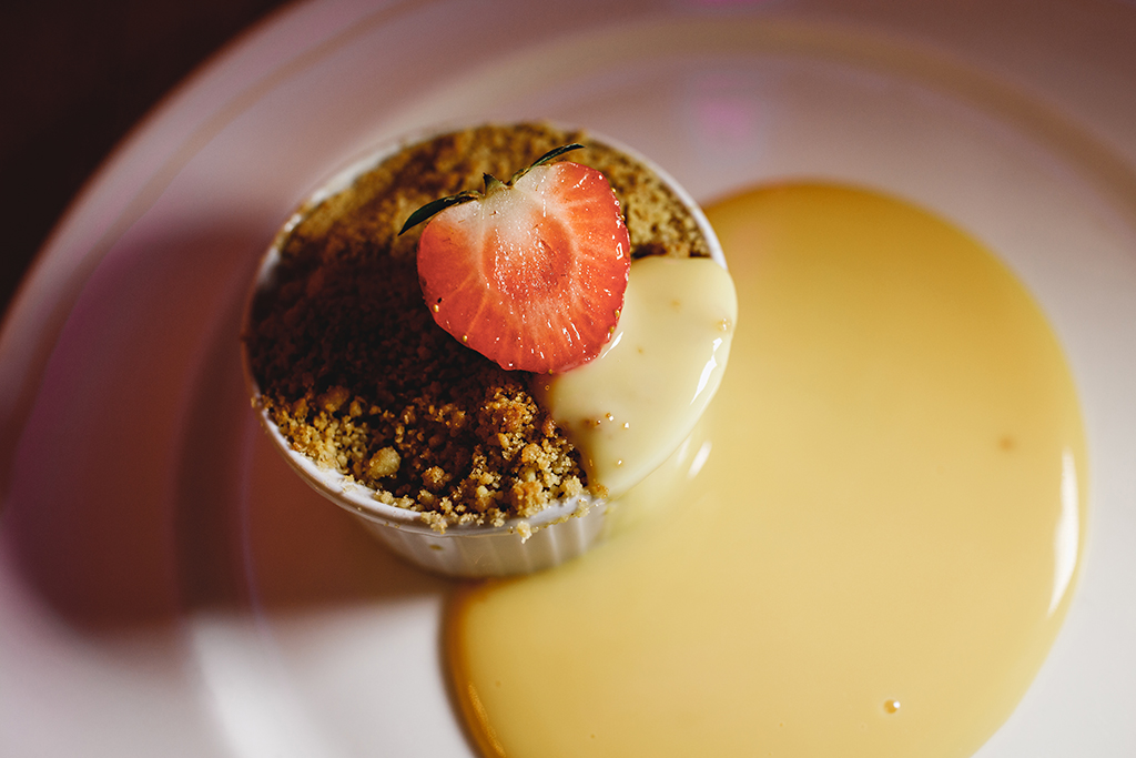 Keep your guests feeling cosy at your rustic winter wedding by serving comforting puddings like fruit crumble and custard at Sandhole OakBarn in Cheshire