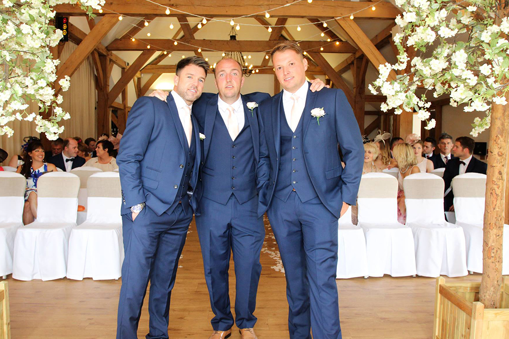 The groom and groomsmen prepare for the wedding ceremony at Sandhole Oak Barn