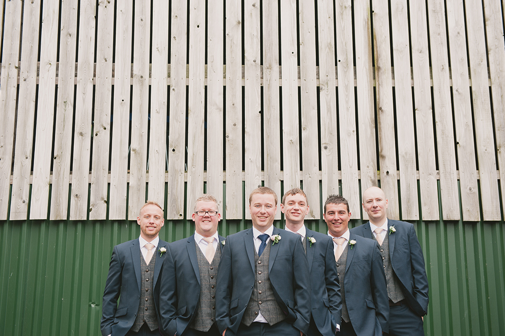 The groom and his groomsmen each wore blue suits with grey tweed waistcoats – wedding ideas