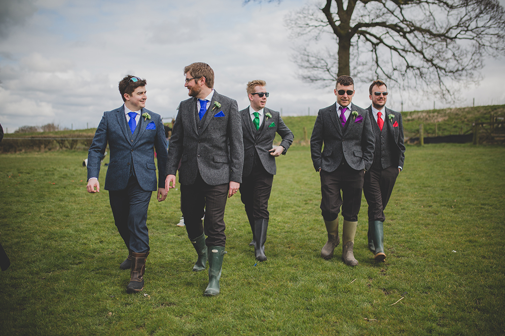 The Groom and Groomsmen wore three-piece wedding suits with grey tweed jackets and waistcoats at this Cheshire barn wedding.