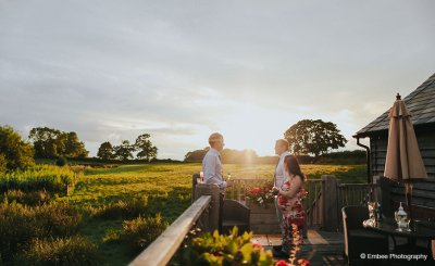 Wedding guests take in the stunning scenery while enjoying their drinks at this exclusive wedding venue in Cheshire