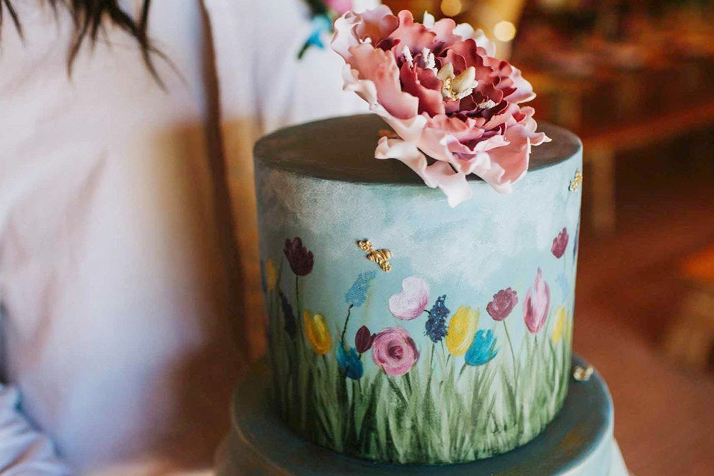 This beautiful hand painted wedding cake is just perfect for a summer barn wedding in Cheshire