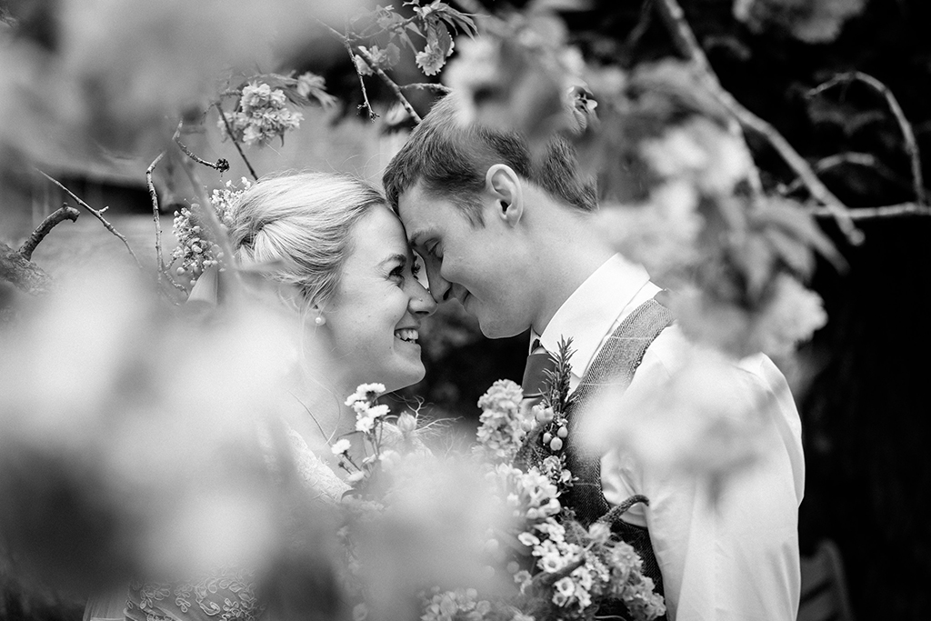The bride and groom have some beautiful wedding photos taken at this rural wedding venue in Cheshire