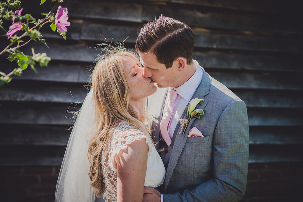 The happy newlyweds share a moment away from the celebrations at their barn wedding in Cheshire