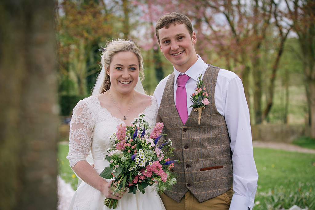 The bride and groom have their wedding photo taken outdoors in this beautiful rural setting in Cheshire