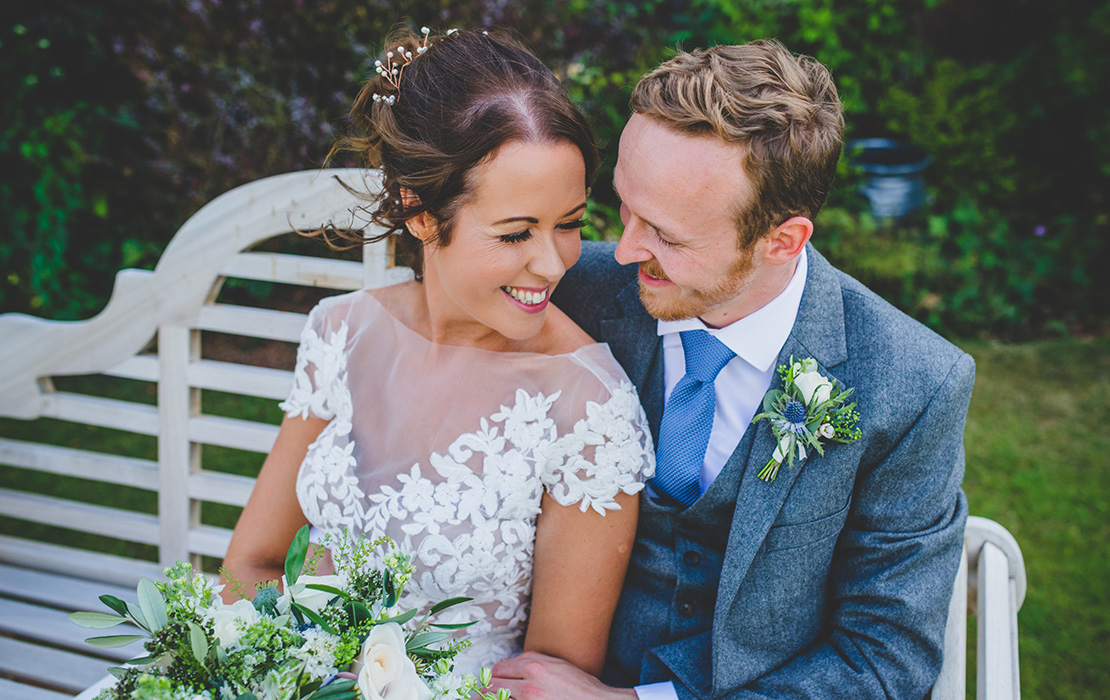 The happy couple enjoy a moment in the gardens at their barn wedding in Cheshire
