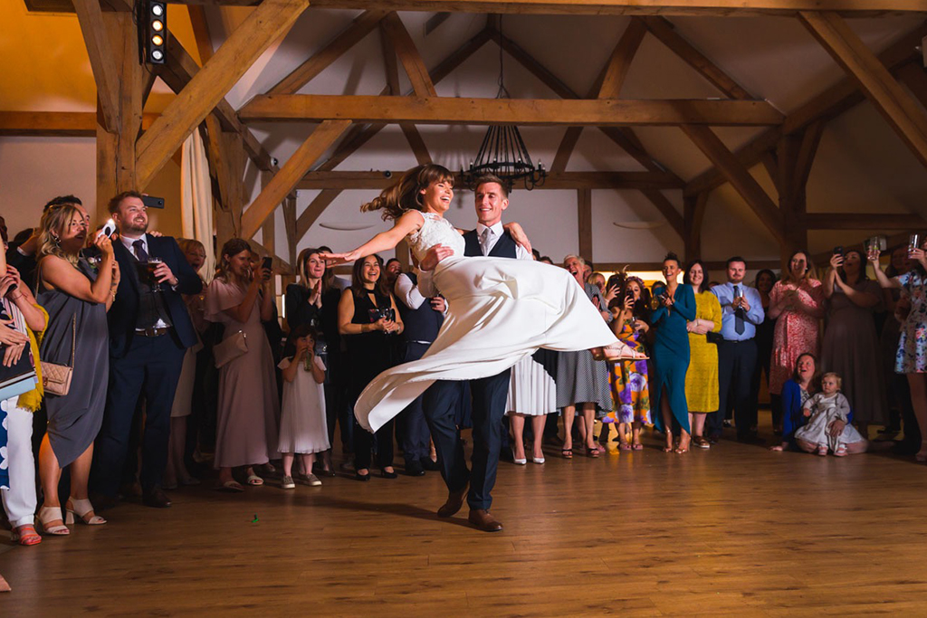 The happy couple take to the dancefloor at their wedding evening at Sandhole Oak Barn