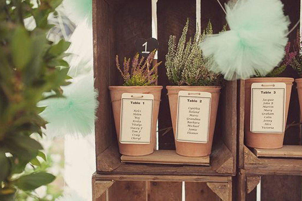 A plant pot table plan is a unique but perfect choice for a barn wedding in Cheshire