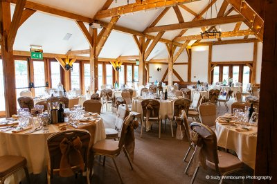 The chairs were decorated with natural hessian sashes and lanterns were placed on each table as centrepieces at this exclusive wedding venue in Cheshire