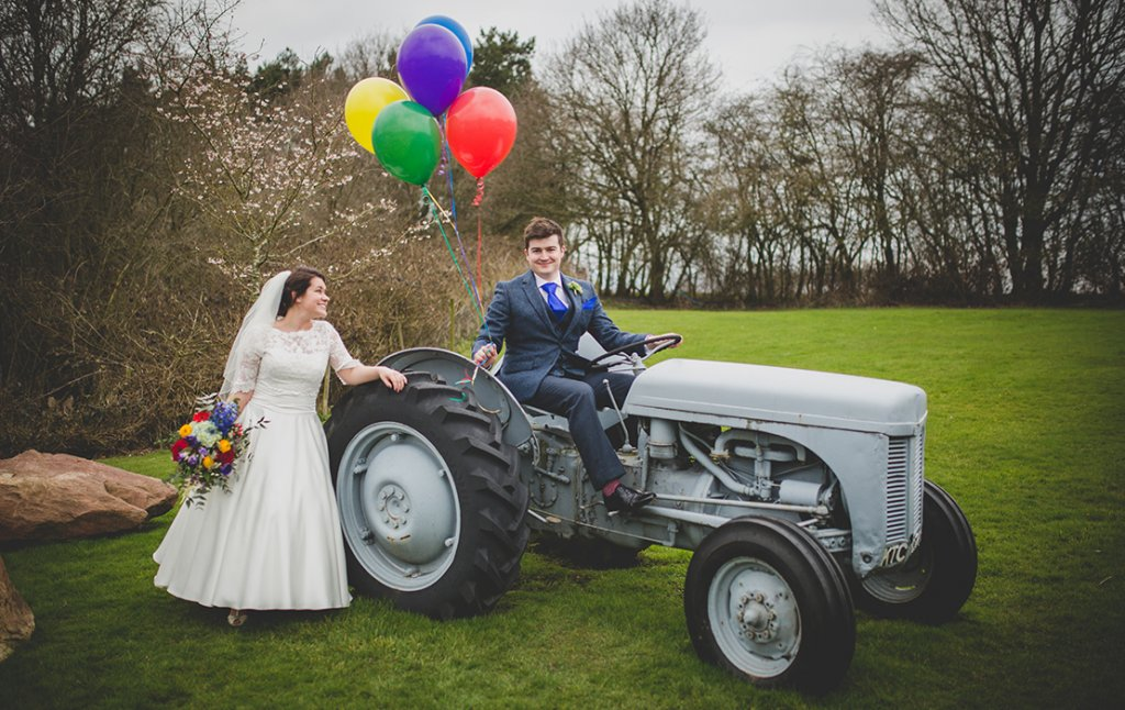 The bride and groom have their wedding photos taken in the surrounding fields at this countryside wedding venue in Cheshire