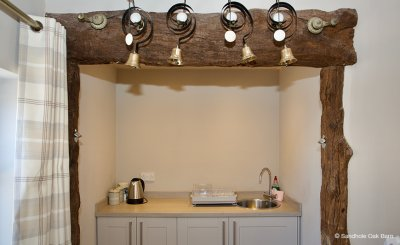 The small barn at Sandhole Oak Barn has a little kitchen area and is a great place for some time away from the party at this wedding barn near Manchester