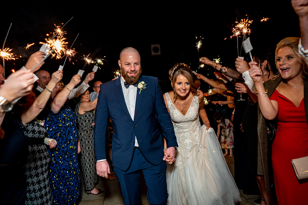 The happy couple enjoyed a sparkler finale at their wedding evening at Sandhole Oak Barn