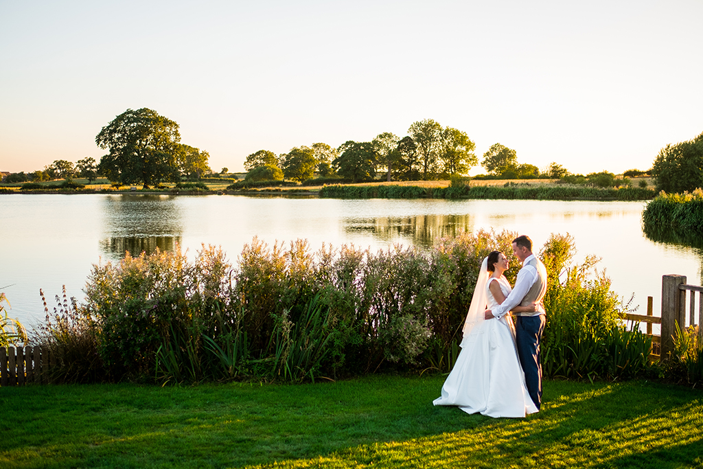 The lakeside is the perfect setting for having romantic wedding photos taken at your barn wedding at Sandhole Oak Barn