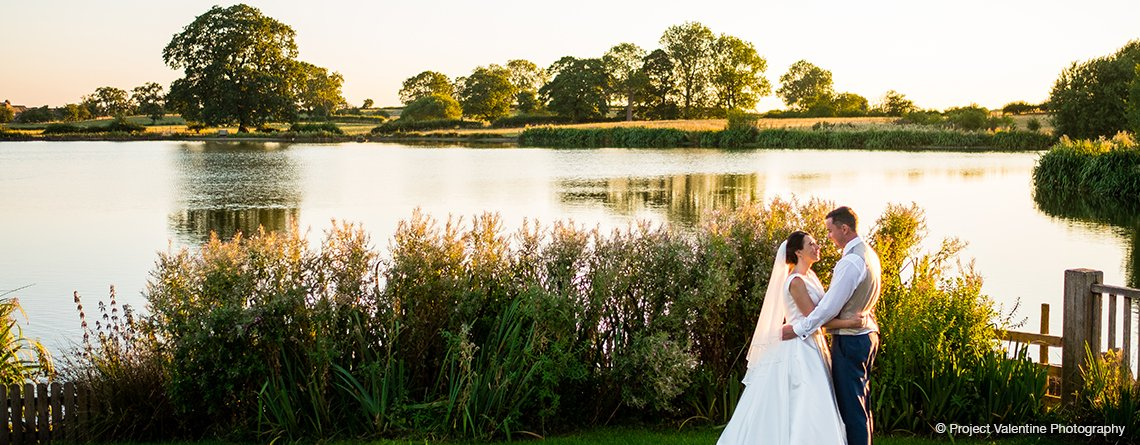 The lake at Sandhole Oak Barn is the perfect backdrop for beautiful wedding pictures at your barn wedding.