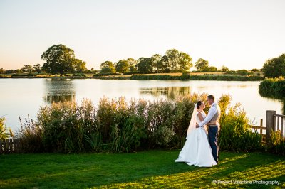 The Clock Tower and lake at Sandhole Oak Barn are perfect for creating dramatic wedding pictures at your barn wedding in the North West