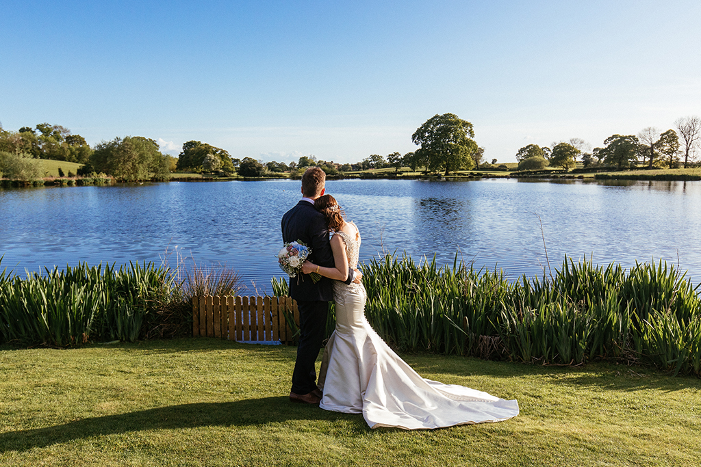The lake at Sandhole Oak Barns offers the most romantic backdrop for your wedding photos at your barn wedding near Manchester