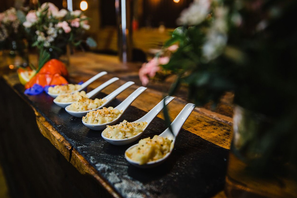 Comforting lobster mac and cheese canapes are a great choice for vegetarians and seafood lovers alike for your winter wedding at Sandhole Oak Barn in Cheshire