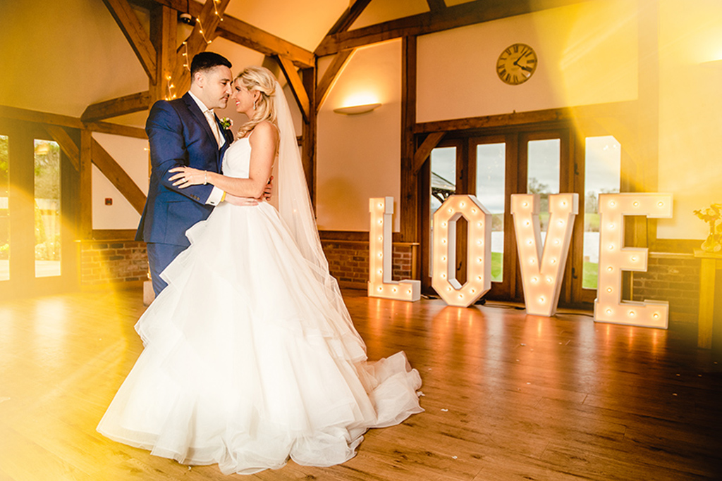 Large light up love letters are perfect for your Valentine barn wedding at Sandhole Oak Barn