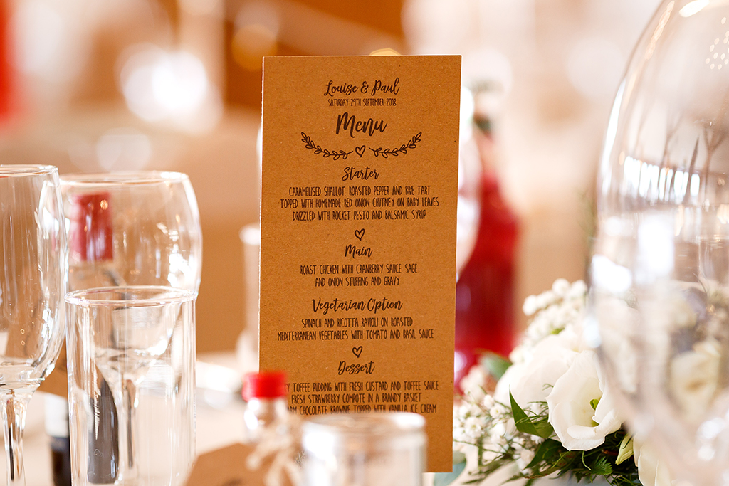 The wedding menus were printed on natural card at this rustic barn wedding in Cheshire