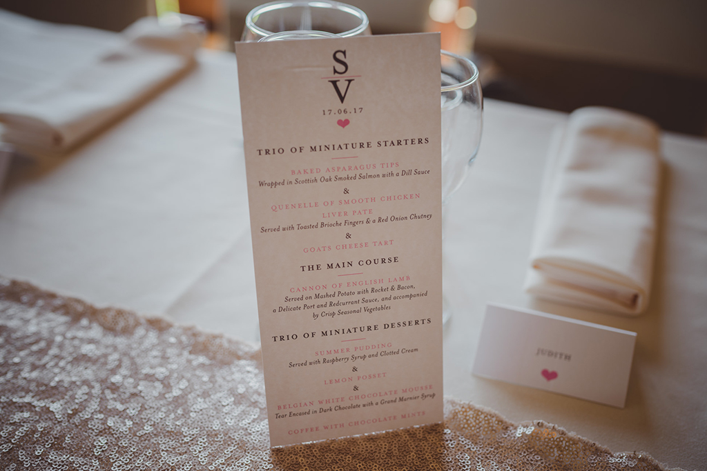 Simply elegant white printed wedding menus were placed at each place setting at this Sandhole Oak Barn wedding